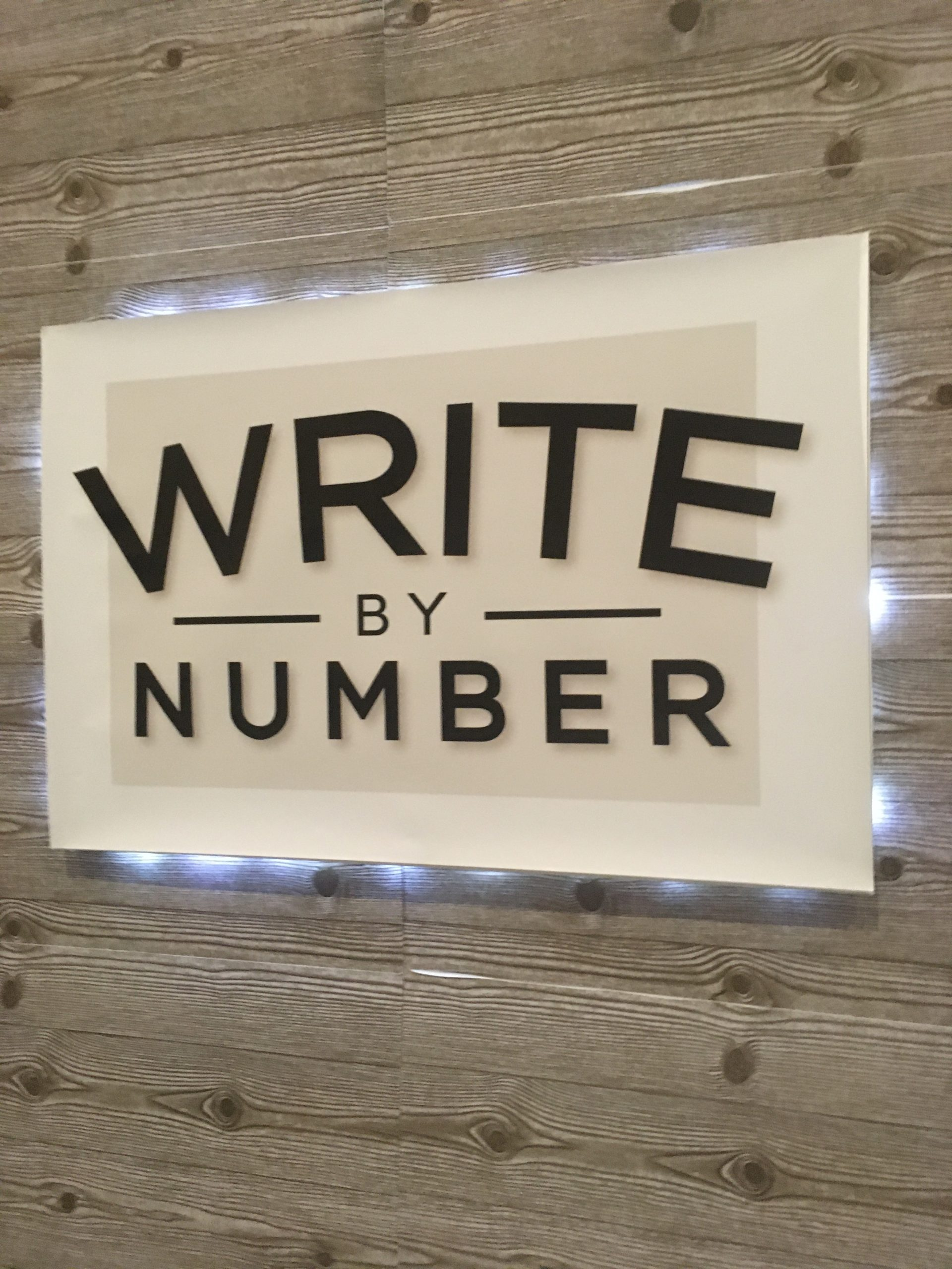 Write by Number exhibit booth sign